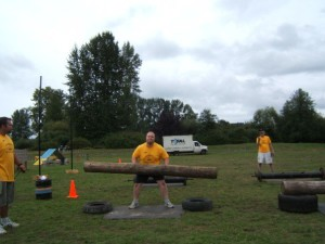 Me attempting the log lift event at an amateur Strongman Competition,
